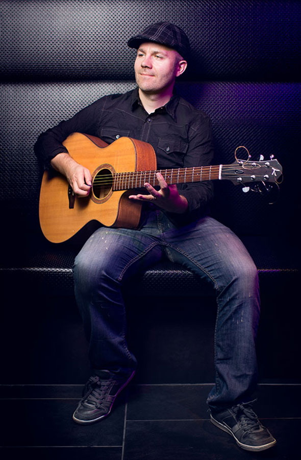 sean meredith-jones with guitar